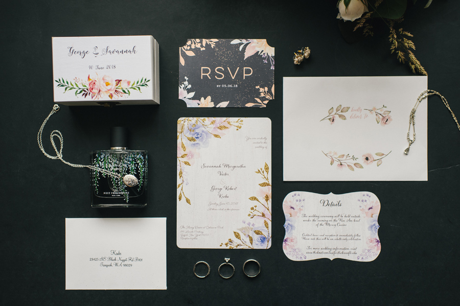 wedding invitation suite with perfume bottle and jewelry