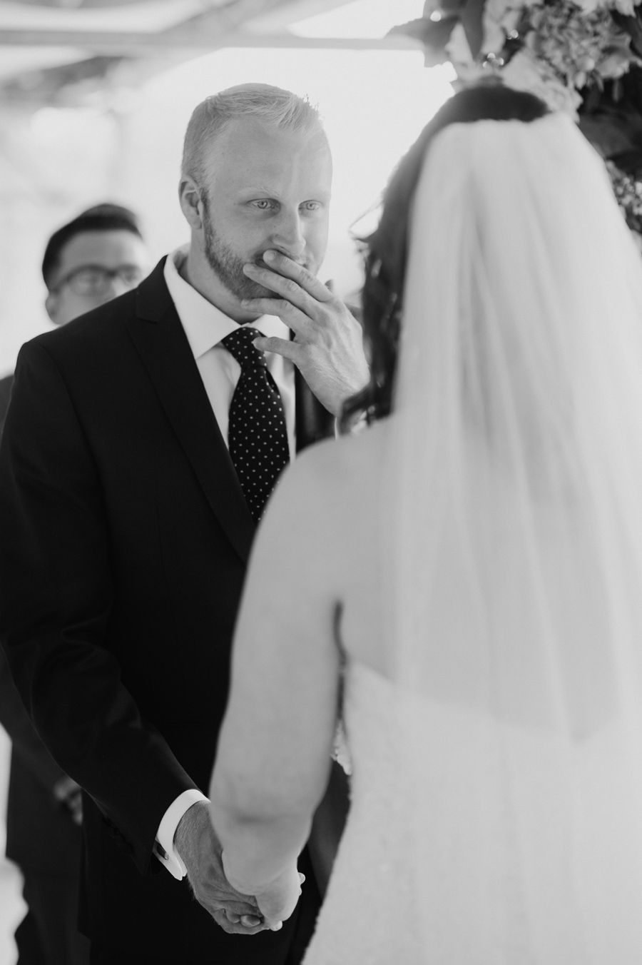 black and white photo of groom looking lovingly at the bride