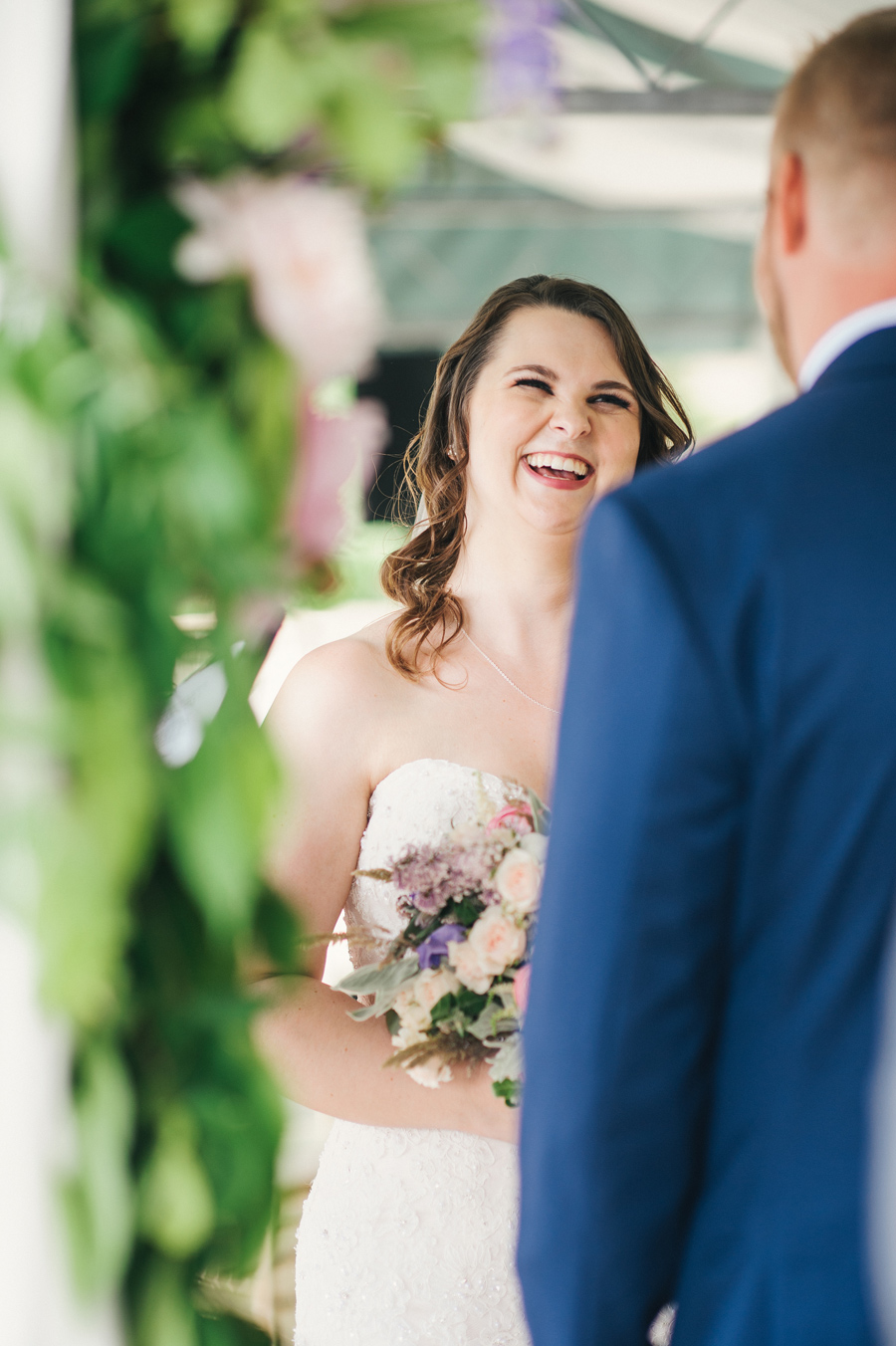 bride laughing during the wedding ceremony