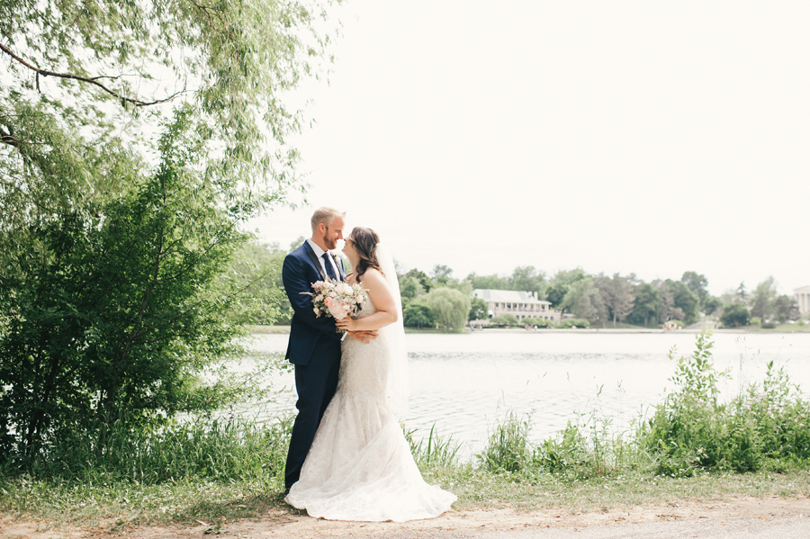 bride and groom in front of hoyt lake across from marcy casino