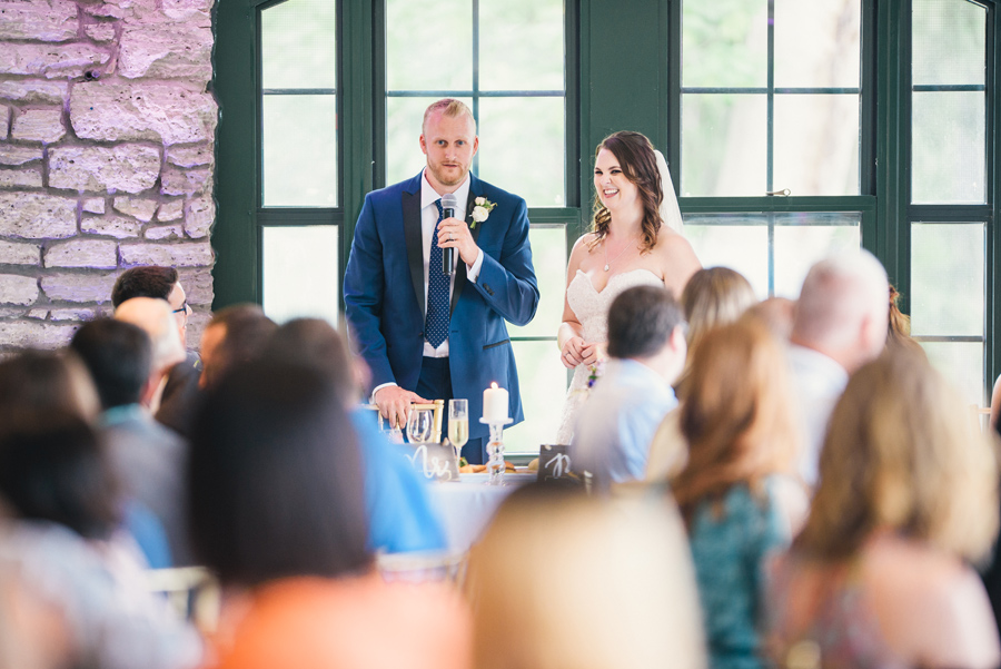 bride and groom giving speech of thanks to wedding guests