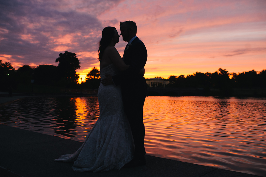 silhouette of bride and groom by hoyt lake at sunset