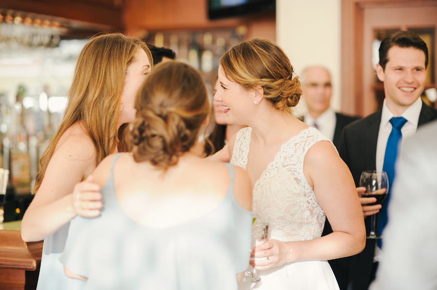 bride mingling with guests at her wedding cocktail hour