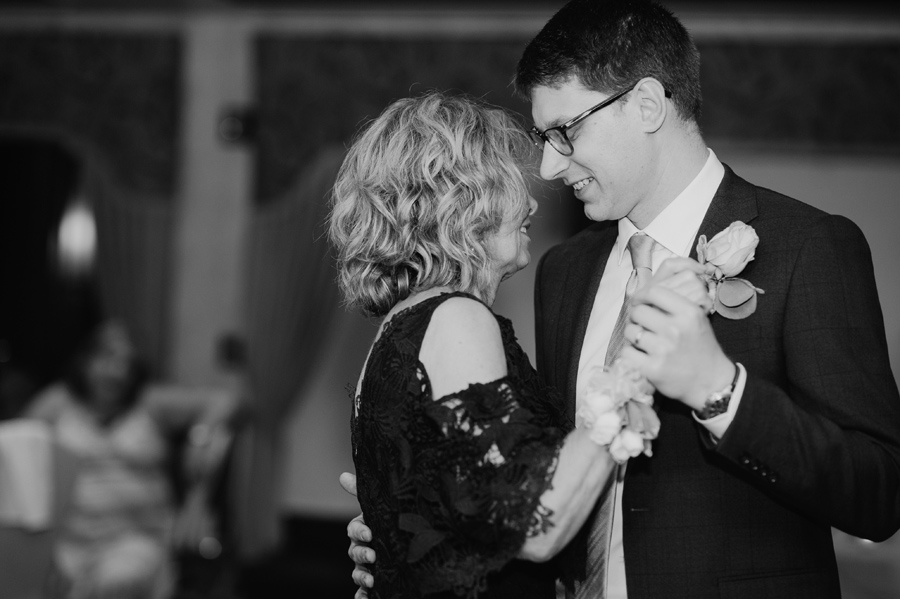 black and white of groom dancing with his mother