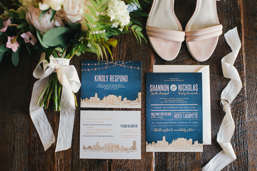 detail shot of invitation suite with bridal bouquet and shoes