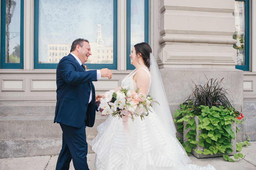 bride and her father seeing each other for the first time on wedding day