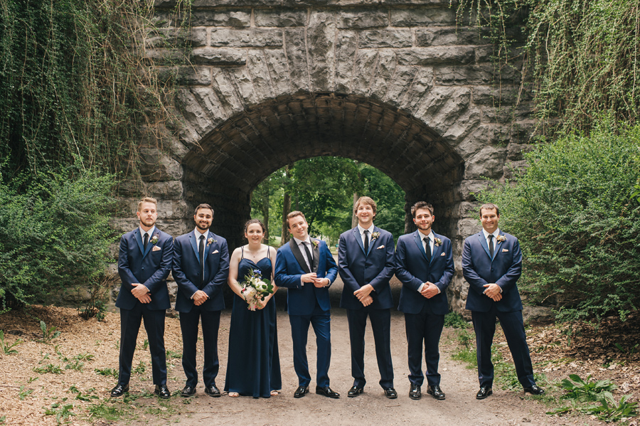groom with his groomsmen and best person in a park