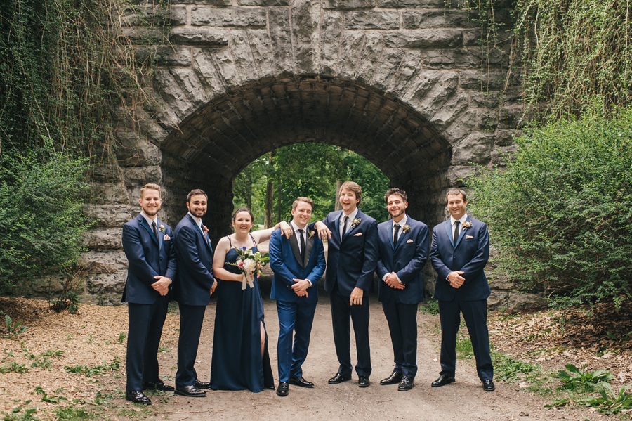 full length of groom and groomsmen acting casual for the camera