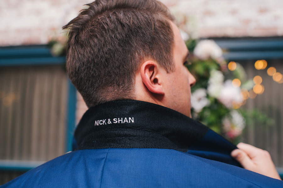 Nick & Shan embroidered underneath the groom's suit jacket collar