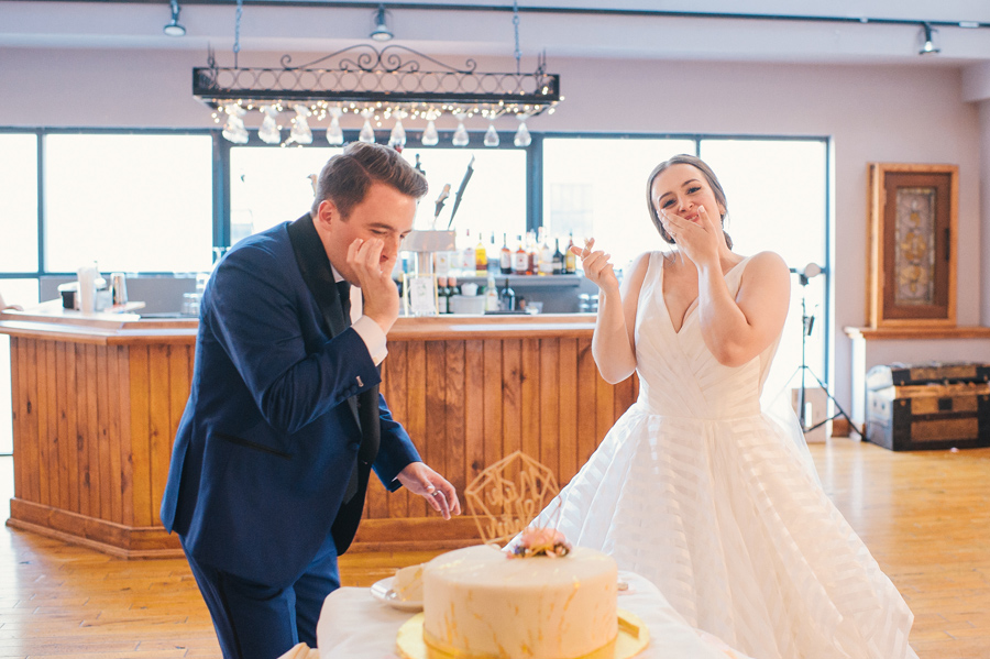 bride and groom tasting their wedding cake together