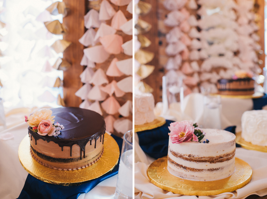 side by side shot of a chocolate cake with cascading chocolate ganache and a naked white cake adorned with pink flower