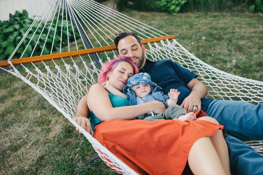 family laying together in a hammock