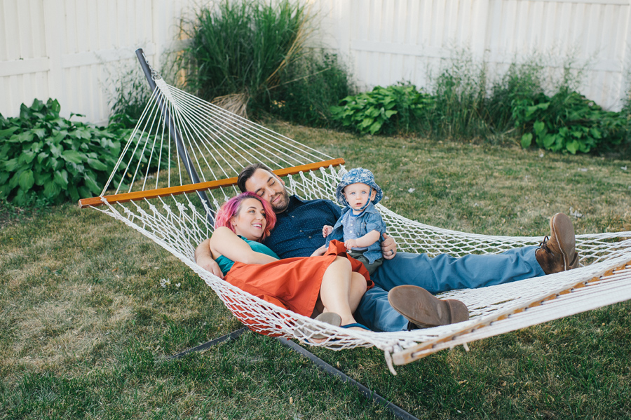 mom dad and baby in a hammock together