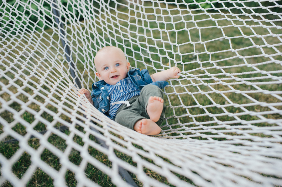baby boy in a large hammock close up