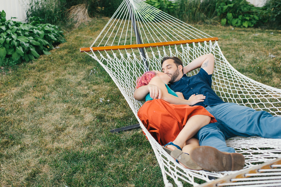 husband and wife kissing in hammock